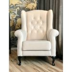 Fotel wypoczynkowy pikowany Uszak II. Fotel tapicerowany aksamitną tkaniną.