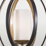 Lampa wisząca brązowo - złota Arizona 2 posiada ruchomą obręcz i pasuje do salonu w stylu loft. Lampa posiada regulowaną wysokość.