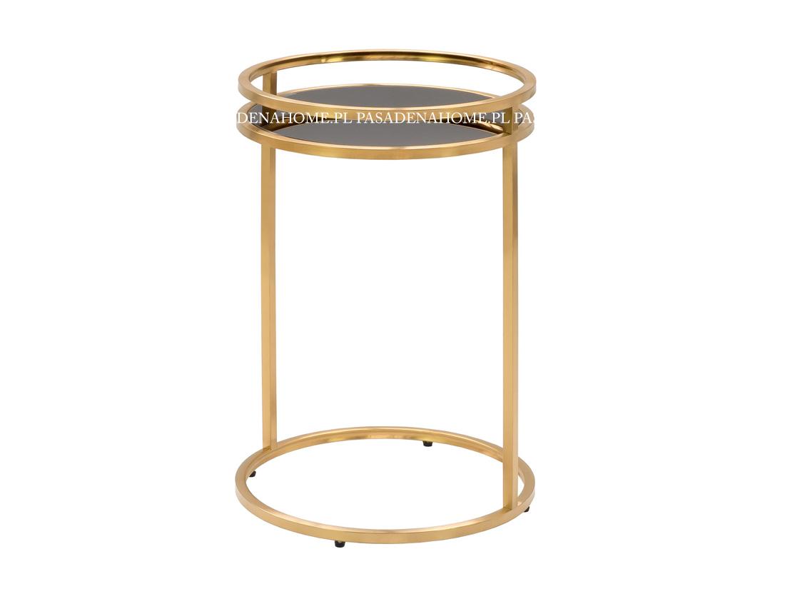 Okrągły stolik Round ze szklanym, przyciemnianym blatem i złotym, matowym stelażem. Stolik kawowy pasuje do wnętrz w stylu nowoczesnym i nowojorskim.