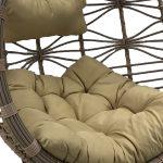 Huśtawka ogrodowa kokon Drop z wygodnymi poduszkami osadzona na metalowym stelażu.Fotel wiszący do ogrodu i na taras zapewni długie chwile relaksu.